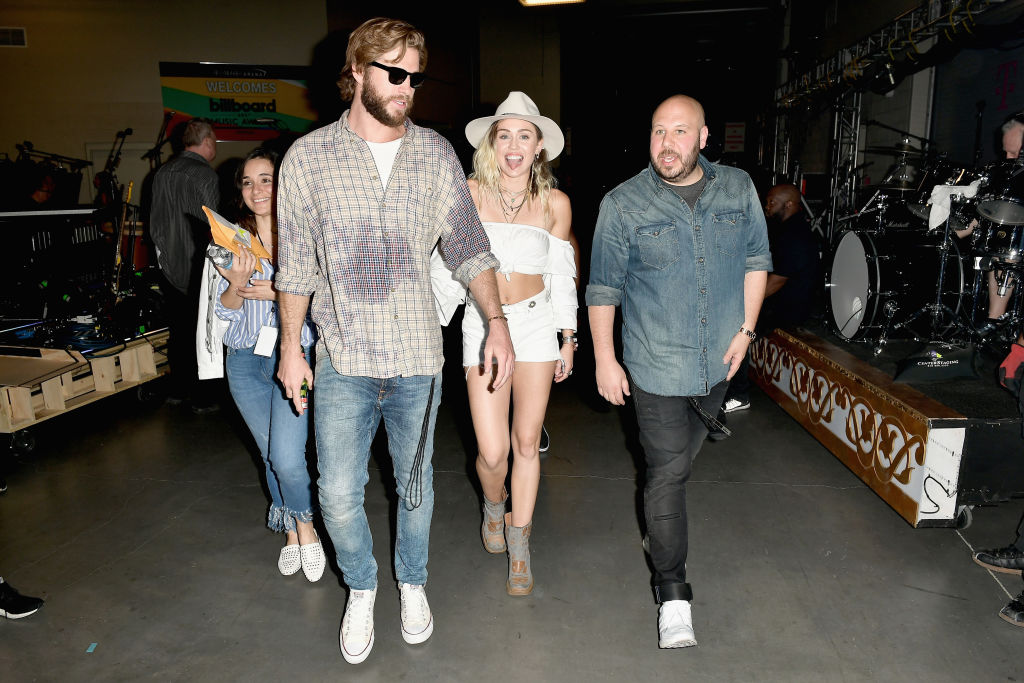 Miley Cyrus and Liam Hemsworth backstage at the Billboard Music Awards.