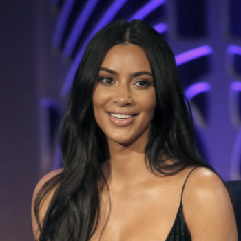Only Kim Kardashian could pull off yoga pants and a bralette to go to dinner