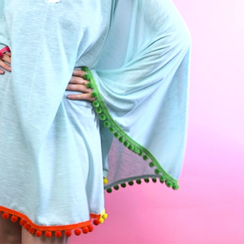 This DIY rainbow pompom cover-up will be your new beach uniform