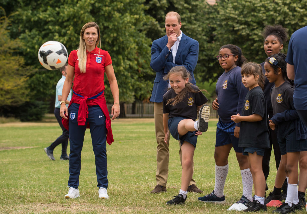 Britain's Prince William, Duke of Cambridge, (C) takes part in football practice with members of the Wildcats Girls' football programme as he hosts a reception for the England women's football team at Kensington Palace in London on July 13, 2017.