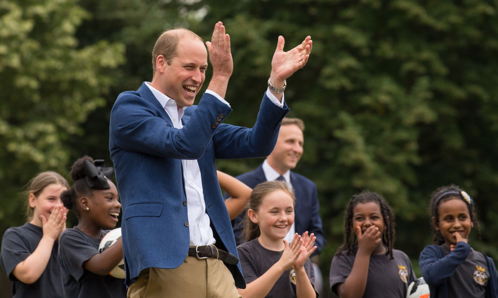 LONDON, ENGLAND - JULY 13:  Prince William, Duke of Cambridge laughs and applauds as he attends a kick-about with the Lionesses and local girls team from the Wildcats Girl' Football programme on July 13, 2017 in London, England.