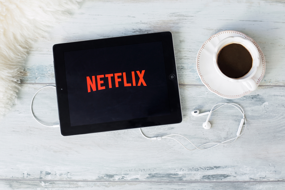 Netflix *knows* you're binging in public — but don't worry, half the population is, too