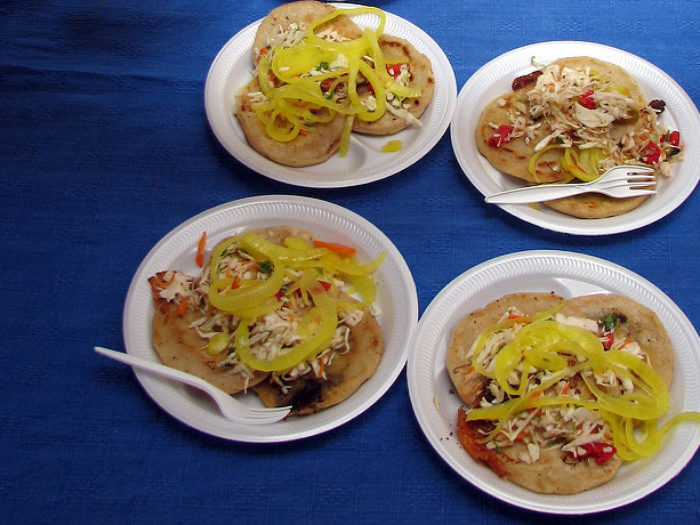 Pupusas on blue background