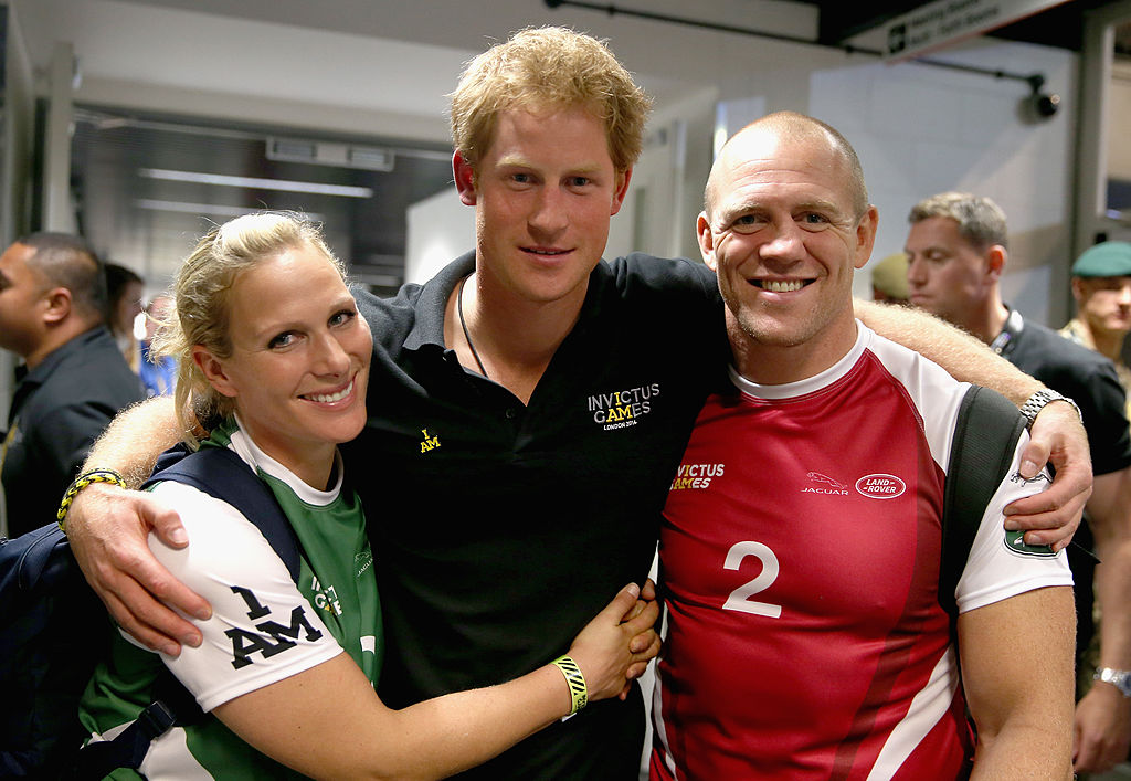 Prince Harry, Zara Phillips and Mike Tindall pose for a photograph after competing in an Exhibition wheelchair rugby match at the Copper Box ahead of tonight's exhibition match as part of the Invictus Games at Queen Elizabeth park on September 12, 2014 in London, England.