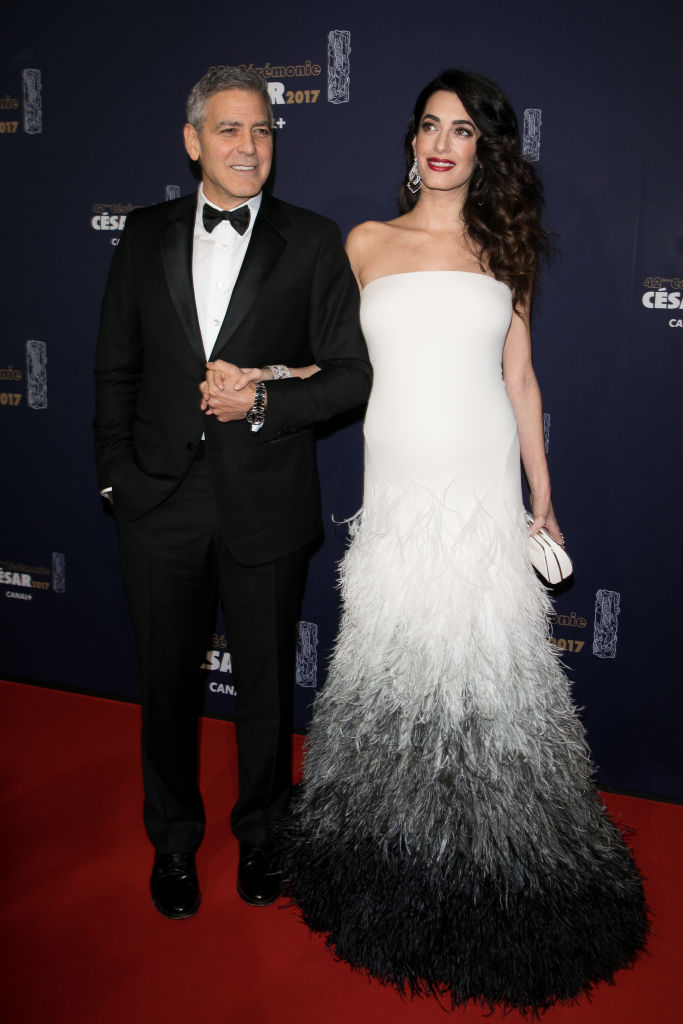 Amal Clooney and husband George Clooney attend the 'CESARS Film Awards 2017' ceremony at Salle Pleyel on February 24, 2017 in Paris, France.