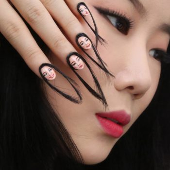 This selfie nail art is so extra, it uses hair instead of paint