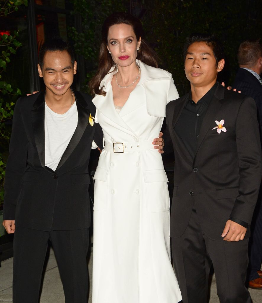Angelia Jolie's kids all wore yellow flowers to her movie ...