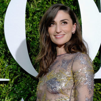 Sara Bareilles looks like a high fashion bumblebee in this black and yellow striped dress