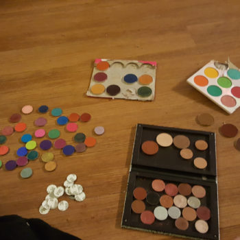 This girl reorganized all 200 of her eyeshadows into one giant rainbow palette
