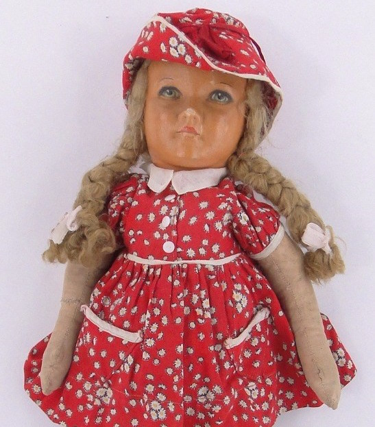 Doll in red dress