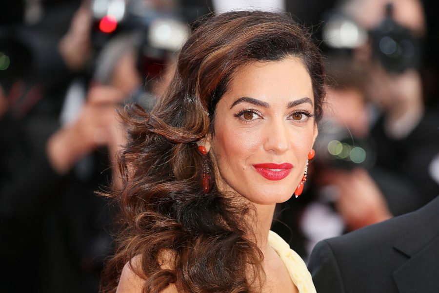 Amal Clooney is back to crushing it at work three months after giving birth