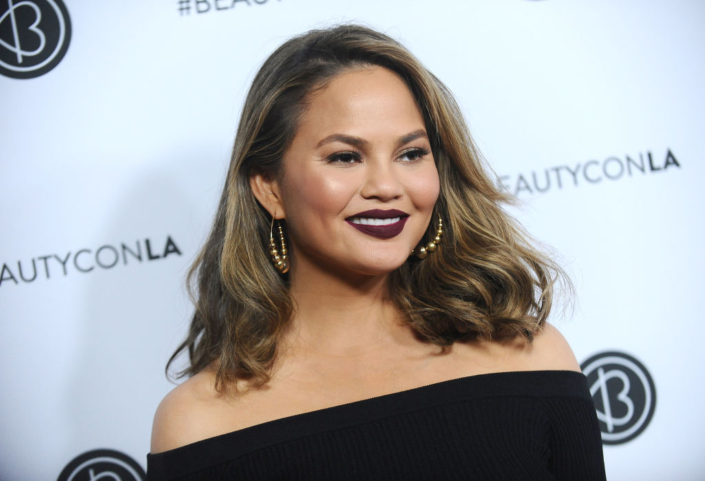 Chrissy Teigen shared the tattoos she *almost* got, and they're extremely early 2000s