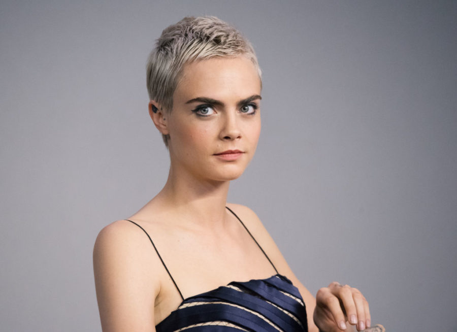 Cara Delevingne is letting her buzz cut grow in naturally, and we dig this