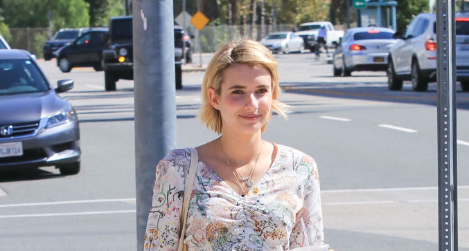 Emma Roberts' crop top and ripped jeans are the perfect outfit combo for a coffee run