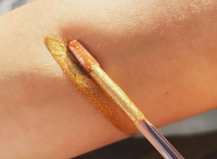 Too Faced teased a new Melted lipstick that is infused with *actual* gold