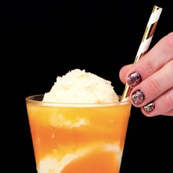 This grown-up candy corn float cocktail will corn-plete you on Halloween