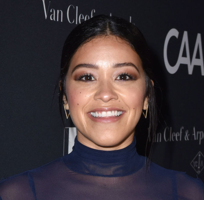 Gina Rodriguez's navy peekaboo dress is the perfect outfit to wear to a fall wedding