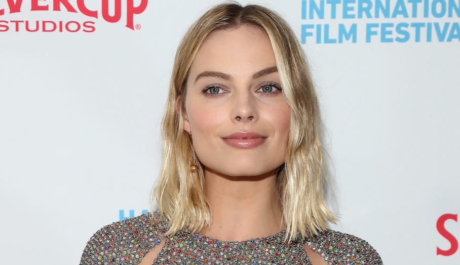 Margot Robbie looks like a rainbow disco ball in her sparkling mini dress