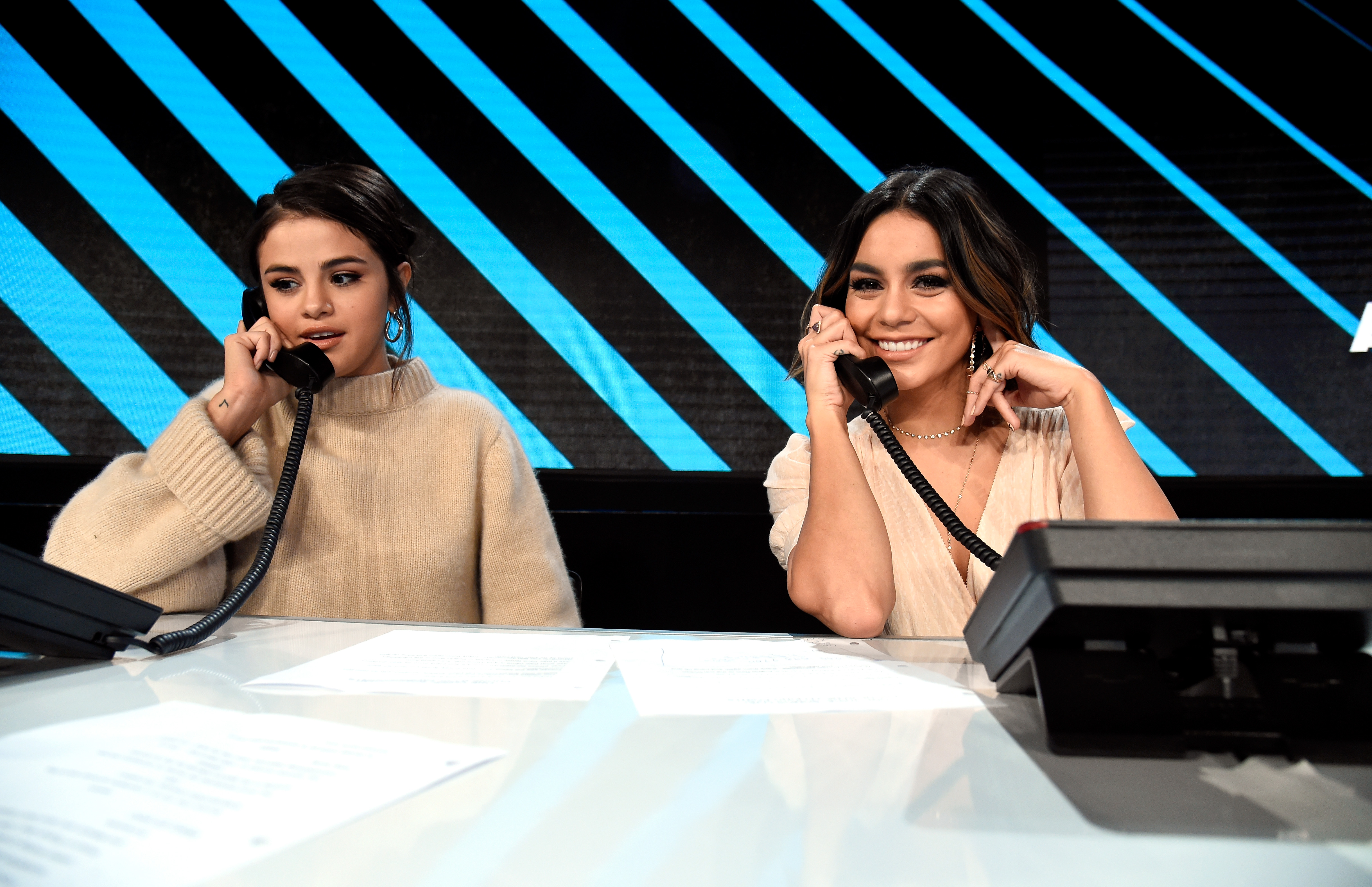 LOS ANGELES, CA - OCTOBER 14:  In this handout photo provided by One Voice: Somos Live!, Selena Gomez and Vanessa Hudgens participate in the phone bank onstage during  One Voice: Somos Live! A Concert For Disaster Relief  at the Universal Studios Lot on October 14, 2017 in Los Angeles, California.  (Photo by Kevin Mazur/One Voice: Somos Live!/Getty Images)