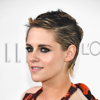 Kristen Stewart looks like the mayor of Halloweentown in this orange suit