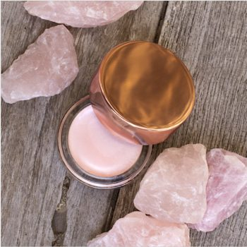 This baby pink luminzer from Miranda Kerr's skin care line will match your rose quartz crystals