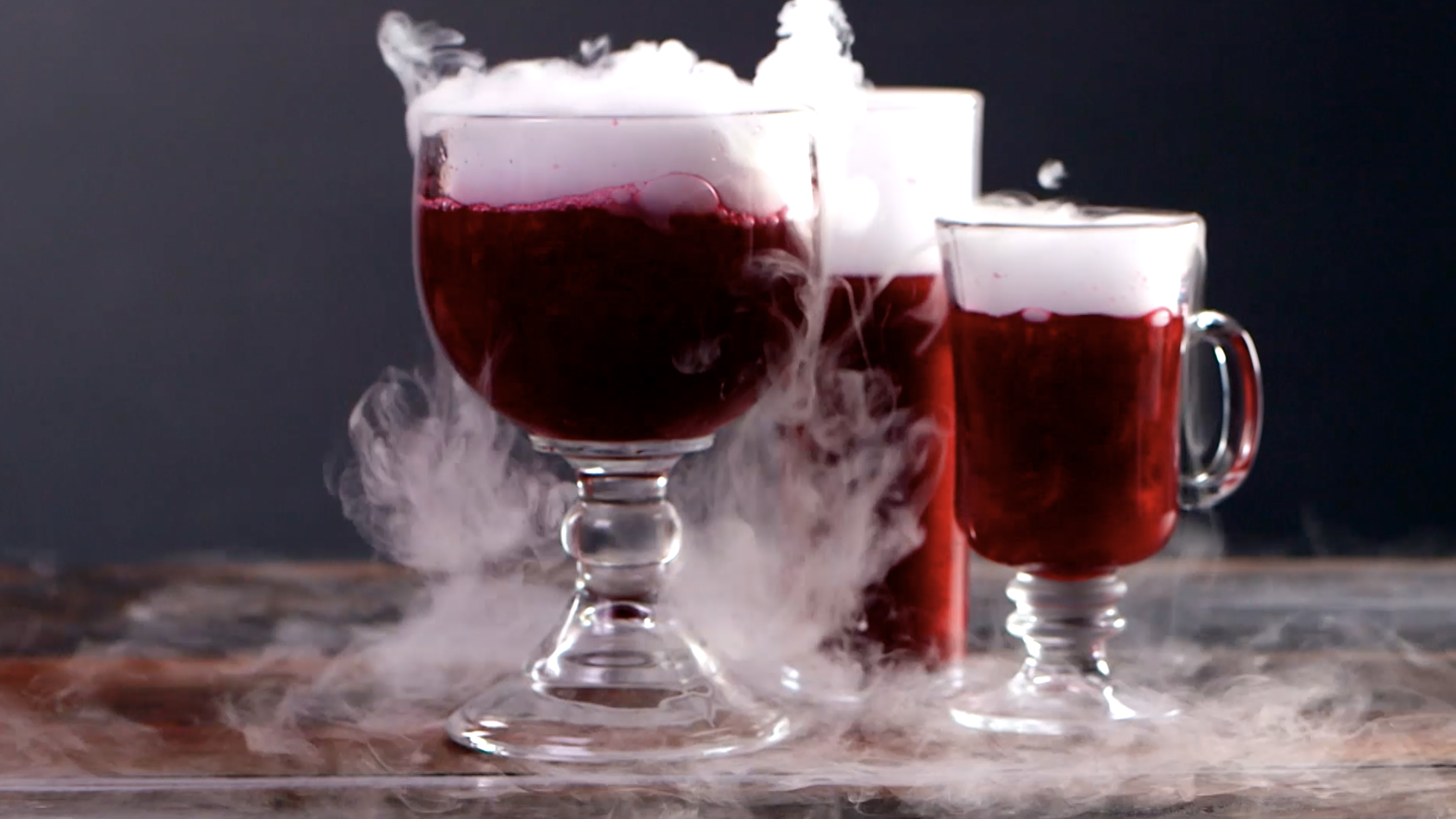 These magical cursed apple-tinis shimmer and smoke in the spookiest way