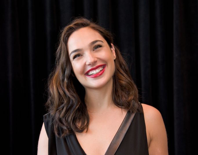 Gal Gadot looks like a chic Inspector Gadget in her trench coat, and here's where to buy it