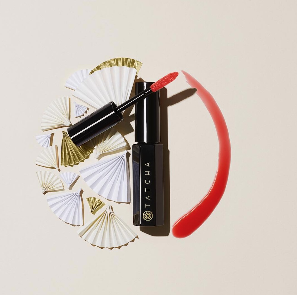 Tatcha's new red tinted lip oil is perfect for all of your holiday glam needs