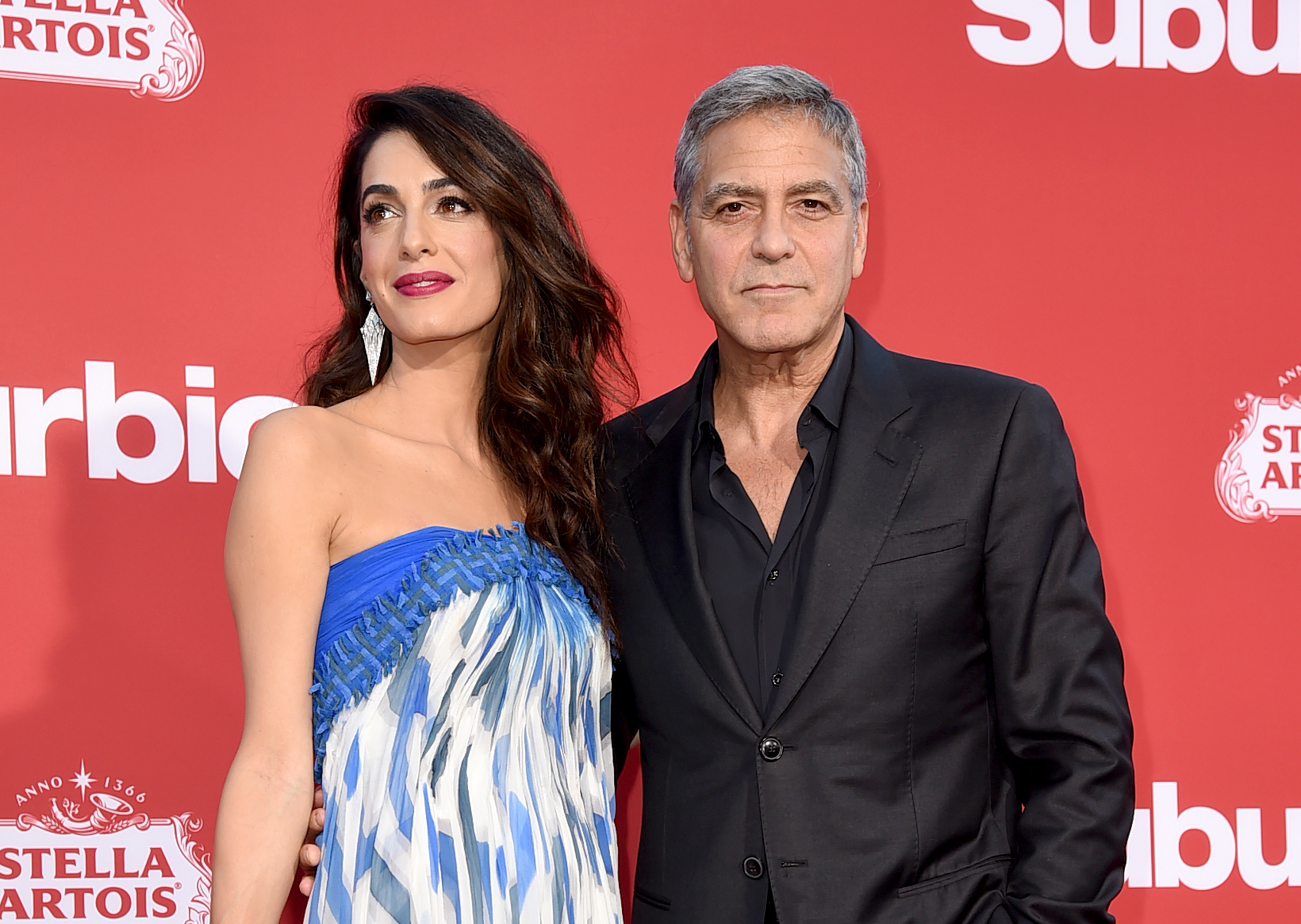 LOS ANGELES, CA - OCTOBER 22:  Executive producer George Clooney (R) and his wife Amal Clooney arrive at the premiere of Paramount Pictures'  Suburbicon  at the Village Theatre on October 22, 2017 in Los Angeles, California.  (Photo by Kevin Winter/Getty Images)