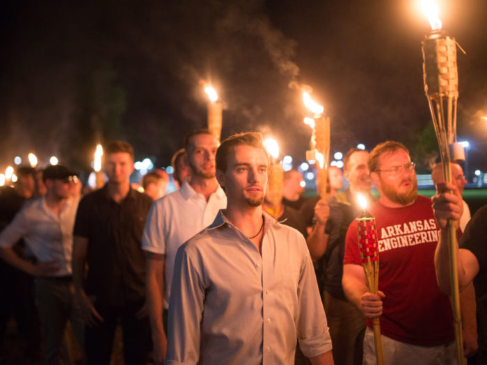 Neo Nazis, Alt-Right, and White Supremacists take part a the night before the 'Unite the Right' rally in Charlottesville, VA, white supremacists march with tiki torchs through the University of Virginia campus. (Photo by Zach D Roberts/NurPhoto via Getty Images)