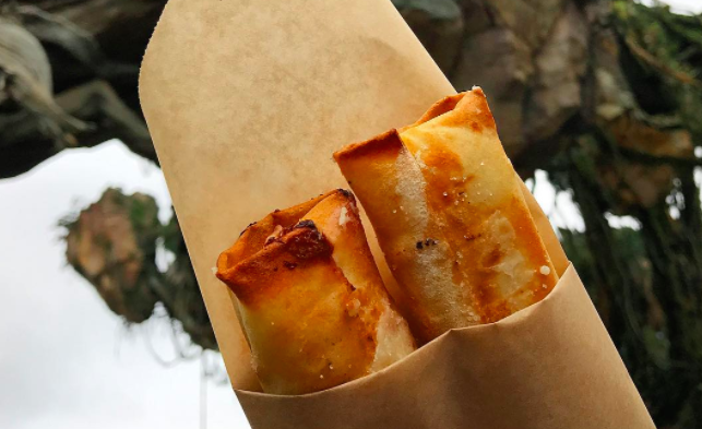 Disney World now has pineapple cream cheese spring rolls, and what a time to be alie