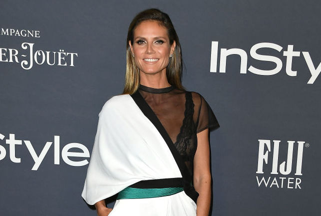 Heidi Klum just dropped some hints about her Halloween costume, and there's a rehearsal involved