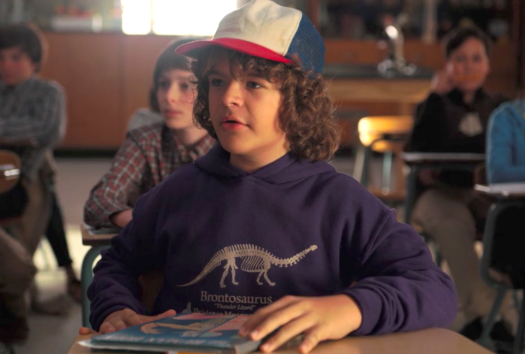 "Here's where you can get Dustin's dinosaur sweatshirt, because ""Stranger Things"" fans need it"
