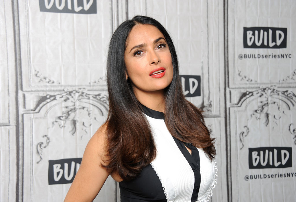 Salma Hayek looks like an '80s mermaid in her holographic gown