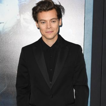 "Harry Styles' new ""Kiwi"" music video involves a cupcake food fight and lots of puppies"