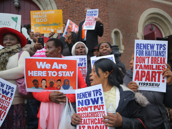 BOSTON, MA - NOVEMBER 5: A rally urging the preservation of TPS (temporary protective status) for Haitians and those from the Latin-American immigrant communities takes place in front of St. Angela Catholic Church in the Mattapan neighborhood of Boston on Nov. 5, 2017. (Photo by Pat Greenhouse/The Boston Globe via Getty Images)
