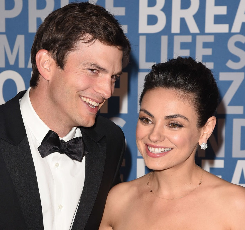 Mila Kunis and Ashton Kutcher make a super rare appearance on the red carpet, look completely in love