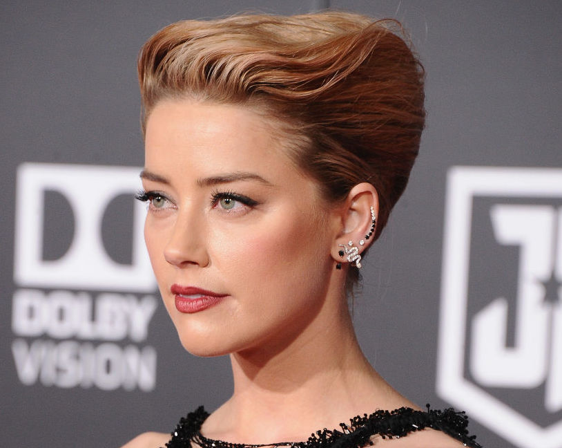 "Amber Heard spoke up after J.K. Rowling and Warner Bros. justified Johnny Depp's role in ""Fantastic Beasts"""