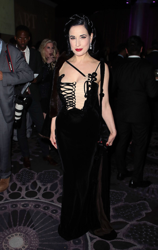 90c6c446166 Dita Von Teese wore a beautiful black velvet dress with corset ...