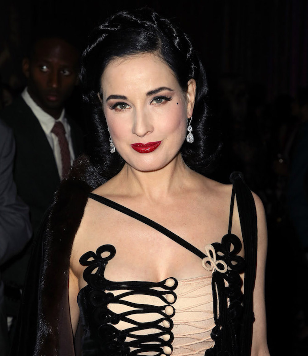 Dita Von Teese's velvet corset dress is holiday party outfit #goals