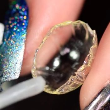 This YouTube guru made a teeny, tiny, snow globe for her nail, and you can even shake it