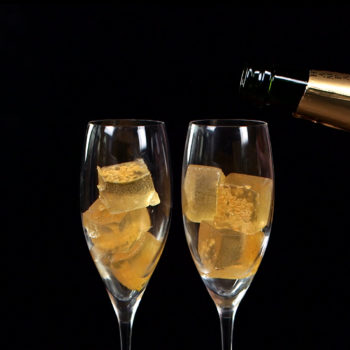 "Ring in your NYE party with classy AF champagne ""jello"" shots drenched in gold"
