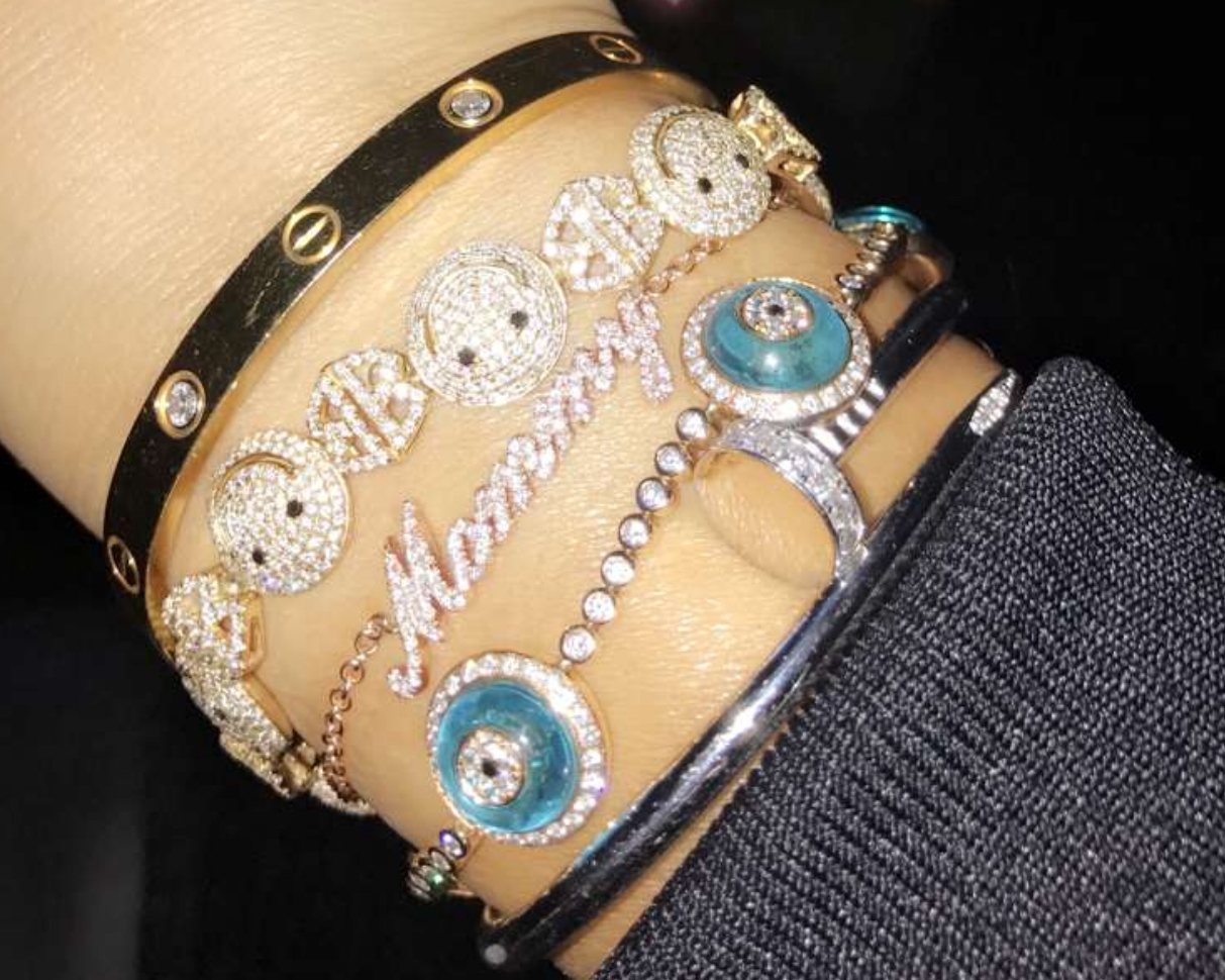 "Pregnant Khloé Kardashian flashed her new diamond ""Mommy"" bracelet on Snapchat"