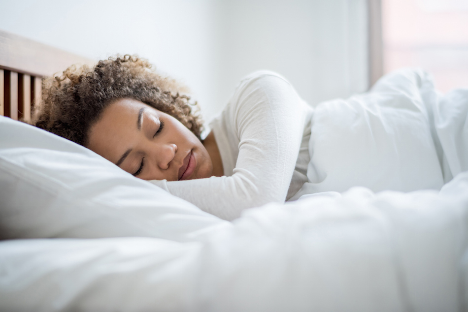 The best sleep positions for whatever type of pain you're experiencing
