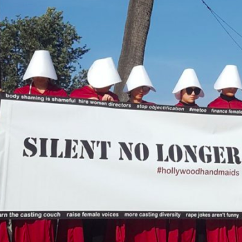 Protesters are dressed up as handmaids outside of the Golden Globes