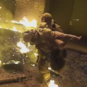 This firefighter caught a child thrown from a burning building, and it was caught on camera