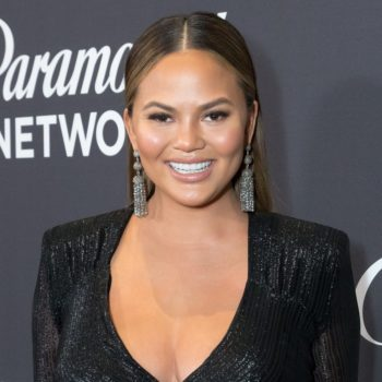 This pic of Chrissy Teigen wearing nothing but maternity shapewear and boob tape is too relatable