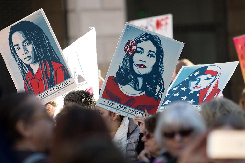 Demonstrators hold signs during the Women's March of Los Angeles