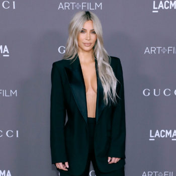 The internet can't figure out what happened to Kim Kardashian's arm in her family's Calvin Klein ad