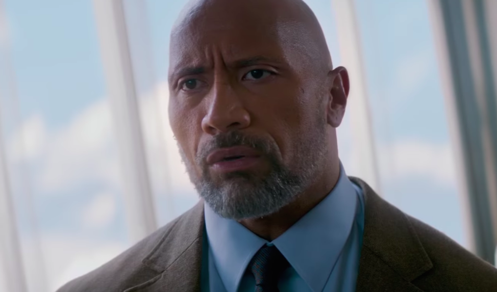 "Watch The Rock literally defy gravity in the first trailer for ""Skyscraper"""